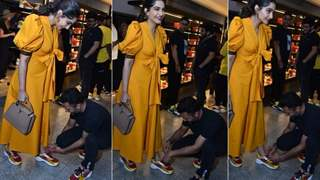 ADORABLE: Anand goes down on his knees to tie Sonam Kapoor's shoelace