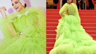 Who knew Deepika Padukone would wear a lime green gown and a pink turban to Cannes?