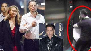 Amber Heard and Elon Musk cuddle up in Johnny Depp's private elevator!