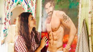 Kriti Sanon gazes at Ranveer Singh's portrait on his birthday in this unseen still from Mimi, see picture!