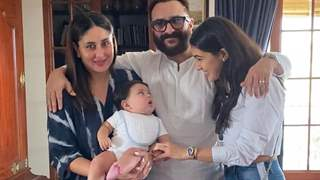 Jeh looks like a cute button in mommy Kareena's arms; Cannot take his eyes off sister Sara