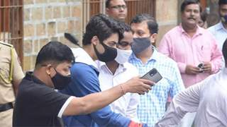 Shah Rukh Khan's fans hold 'Release Aryan Khan' posters outside court before the bail hearing