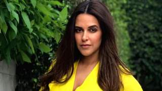 'Freedom to Feed' says Neha Dhupia sharing a picture of breastfeeding her baby boy