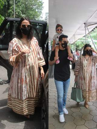 Mommy-to-be Neha Dhupia snapped with husband Angad Bedi and their daughter