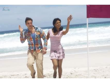 Sohail and Priyanka standing on a beach