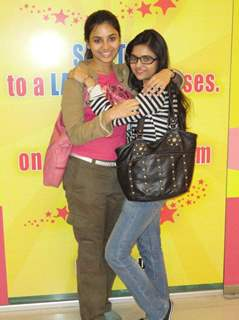 A still image of Deblina Chatterjee and her friend