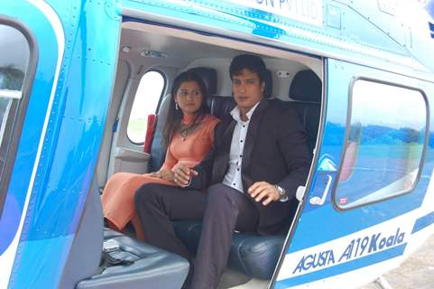Yudhishtir and Rani sitting on a helicopter