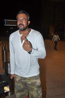 Apoorva Lakia shows his inked finger at Mumbai airport leaving to attend IIFA