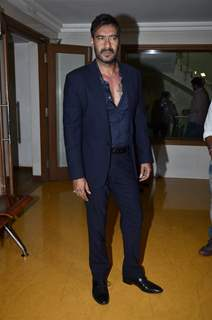 Ajay Devgn poses for the media on the Sets of KBC 8