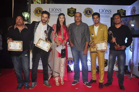 Team of EVEREST poses for the media at Lion Gold Awards