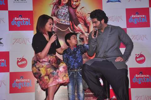 Arjun Kapoor and Sonakshi Sinha interact with a young fan at the Promotions of Tevar