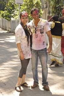 Anup Soni and Juhi Babbar pose for the media at Shabana Azmi's Holi Bash