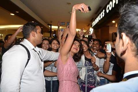 Priyanka Chopra clicks a selfie with fans at the Press Meet of Dil Dhadakne Do at IIFA 2015