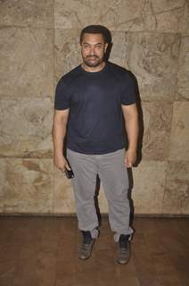 Aamir Khan poses for the media at the Screening of Bajrangi Bhaijaan