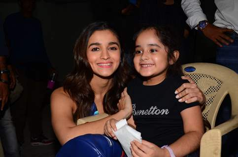 Alia Bhatt poses with a fan at Mehboob Studio