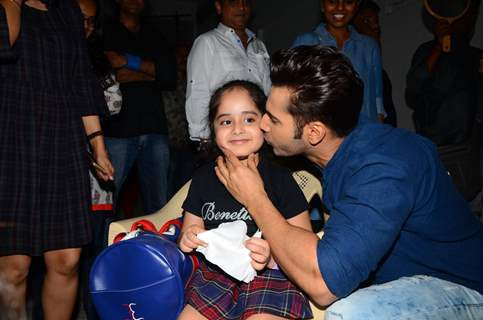 Varun Dhawan poses with a fan at Mehboob Studio