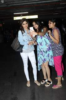 Shamita Shetty obliges a fan with a selfie at Airport