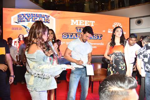 Bollywood actor Tiger Shroff signs autographs for fans