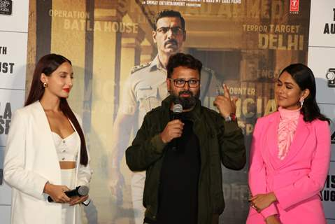 Mrunal Thakur, Nora Fatehi and director Nikkhil Advani were snapped at the trailer launch of Batla House