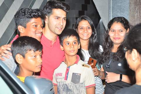 Varun Dhawan snapped otside his gym with his fans