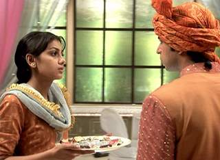 A still image of Sudha and Uday