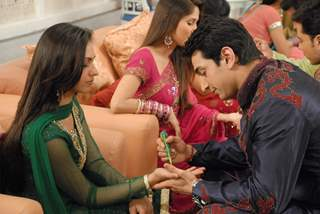 Shantanu putting Mehandi to Nandini