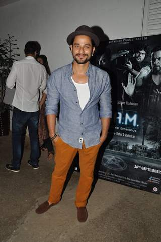 Kunal Khemu poses for the media at the Premier of 3AM