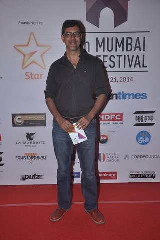 Rajat Kapoor poses for the media at the Closing Ceremony of 16th MAMI Film Festival