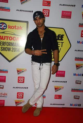 Mohammad Nazim poses for the media at Autocar Show