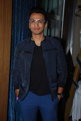 Abhijeet Sawant poses for the media at Lucky's Music Club