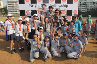 Irfan Pathan poses with Kids at Bright Start Fellowship International School