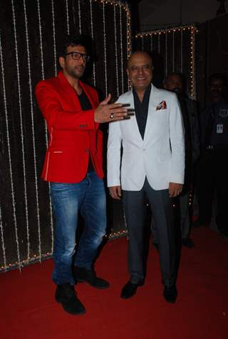 Javed Jaffrey and Naved Jaffrey pose for the media at Bappi Lahiri's Wedding Anniversary