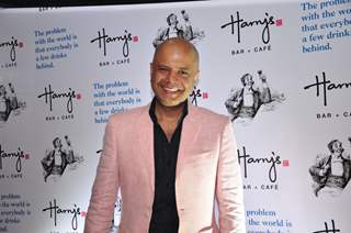 Naved Jaffery poses for the media at the Launch of Harry's Bar & Cafe