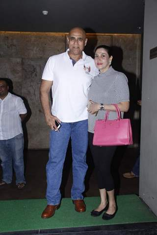 Puneet Issar poses with Wife at the Screening of Bahubali