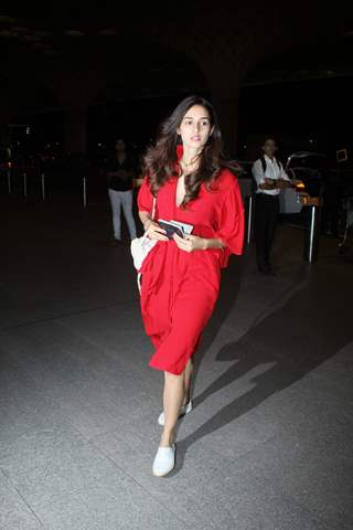 Disha charms in a casual red dress