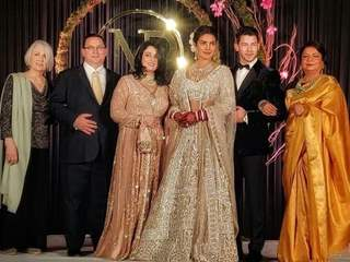 Priyanka and Nick with their family at their Wedding Reception Delhi