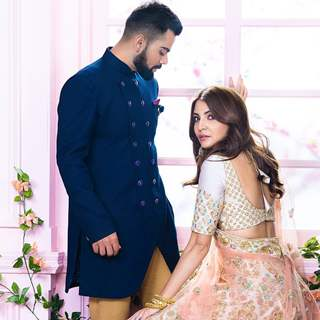 Anushka-Virat sport traditional Indian attire for a photo shoot