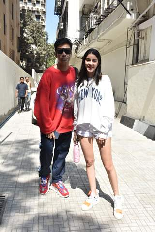Karan Johar and Ananya Panday pose for a picture