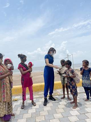 Urvashi Rautela distributes food amongst the needy affected by the cyclone Tauktae