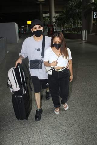 Neha Kakkar and Rohanpreet Singh snapped arriving at Mumbai airport