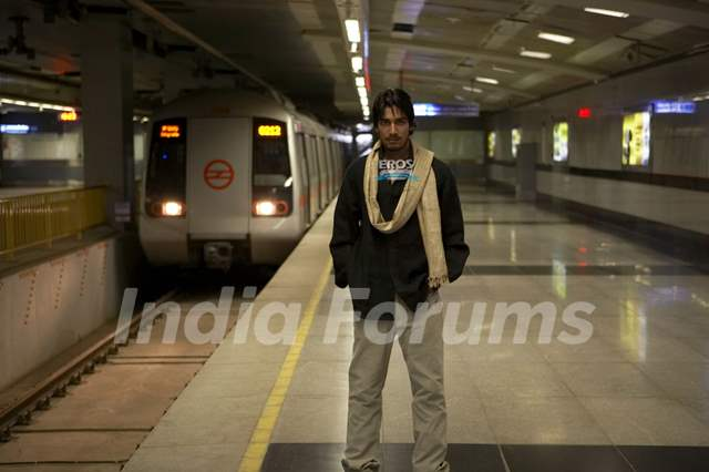 Anurag Sinha standing in a metro station