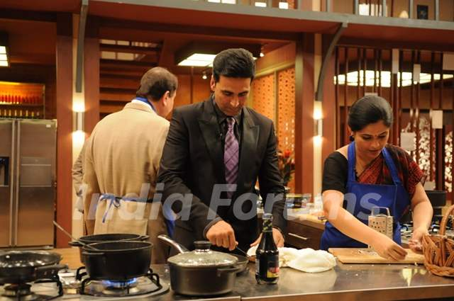 Akshay Kumar helping contestant on tv show Master Chef India