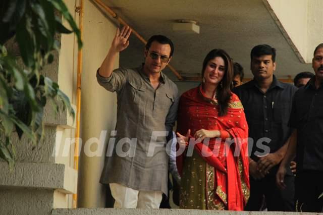 Saif Ali Khan with wife Kareena Kapoor gestures after ... Saif Ali Khan Wife Details