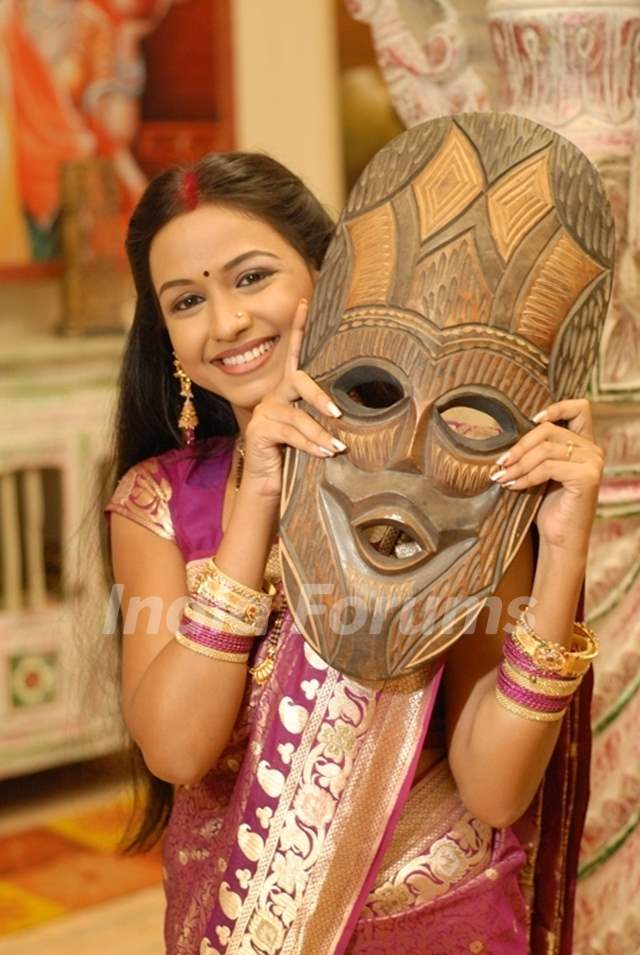 Shree with a wooden mask