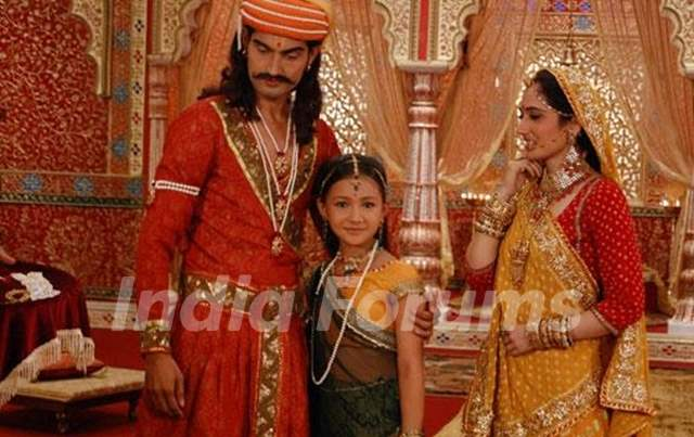 Meera with their parents