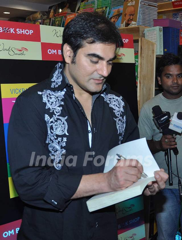 Arbaaz Khan autographs the book Yes Thank You Universe