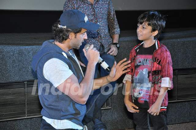 Hrithik Roshan interacts with a young fan at the Special Screening of Bang Bang