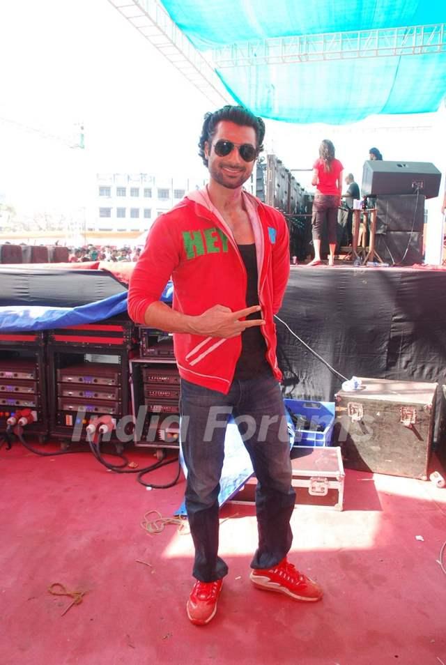 Hanif Hilal poses for the media at Holi Celebrations