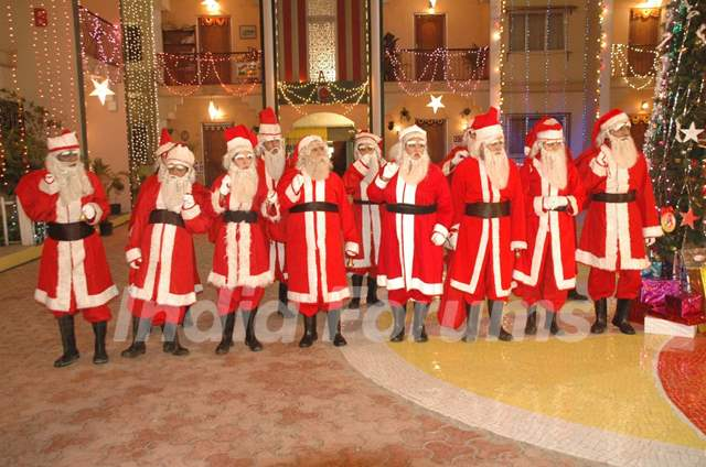 All cast dressed as SantaClaus
