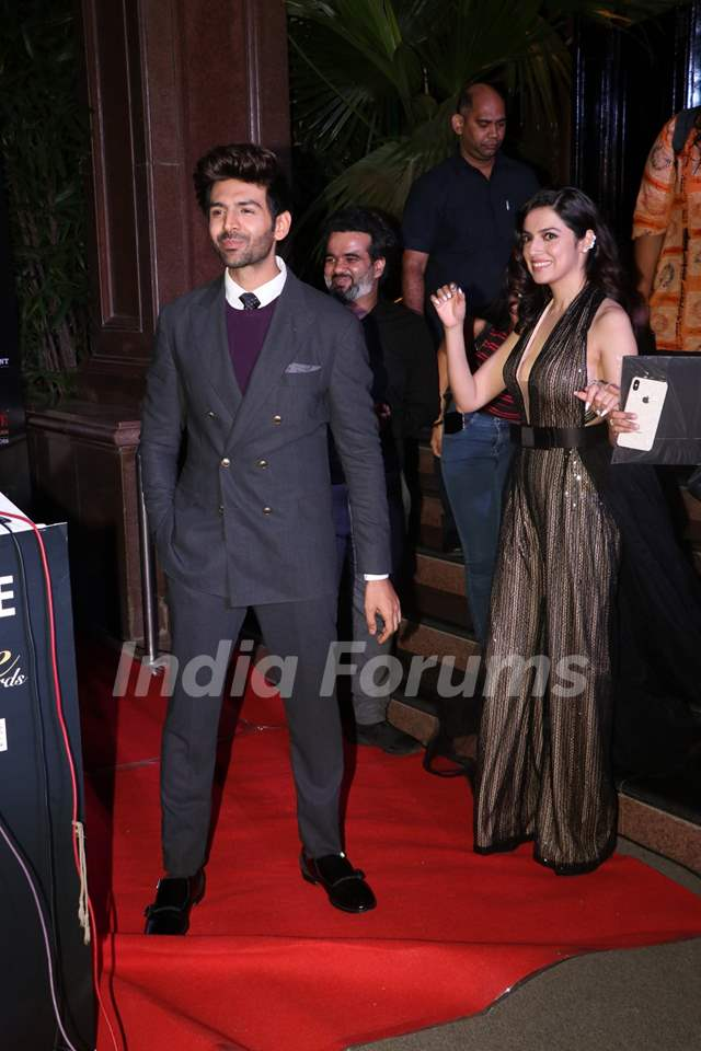 Divya Khosla Kumar and Kartik Aaryan papped at the Red Carpet of Filmfare Glamour and Style Awards 2019